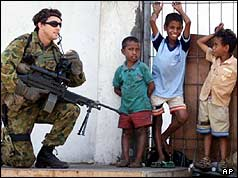 An Australian peacekeeper talks to East Timorese boys