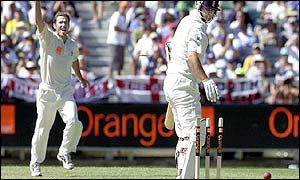 Damien Martyn celebrates taking the wicket of Robert Key