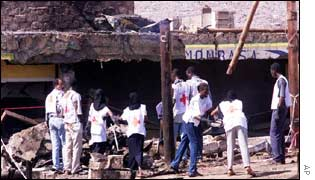 Red Cross workers remove rubble from the Paradise Hotel