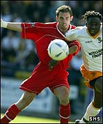 Aberdeen defender Phil McGuire in action against Livingston