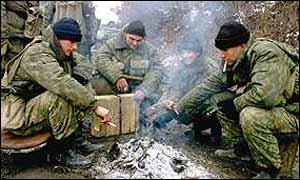 Russian soldiers around a fire