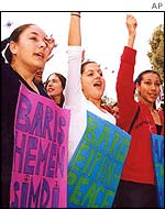 Turkish Cypriot girls hold banners reads: Peace now and Peace during a demonstration in  Nicosia