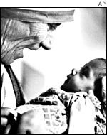 Mother Teresa with an orphan