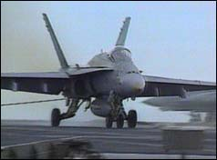 F18 Hornet aircraft landing on the aircraft carrier USS Kitty Hawk