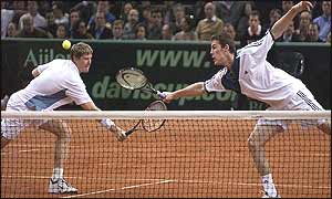 Kafelnikov and Safin stretch for a volley