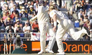 Brett Lee bowls Steve Harmison to claim England's eight and final wicket