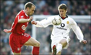 Ole Gunnar Solskjaer tussles with Danny Murphy during a tight first half