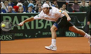 Sebastien Grosjean stretches to return a shot from Marat Safin