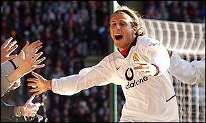 Diego Forlan celebrates his second goal with the travelling fans