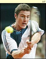Marat Safin hits a backhand against Sebastien Grosjean