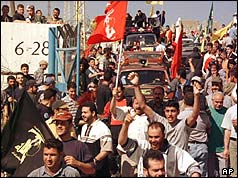 Villagers joyfully return to their village of Houla on 22 May 2000, after the Israeli withdrawal