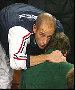 French captain Guy Forget (left) comforts Paul-Henri Mathieu