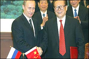 Vladimir Putin and Jiang Zemin (AFP)