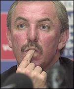 David Graveney puts his finger on his lips