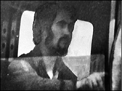 B/W picture of Peter Sutcliffe driving a lorry