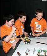 Boys showing off robot skills