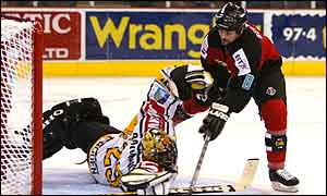 Sean Selmser scores the Giants second goal against Eric Raymond of Rouen in the semi-finals