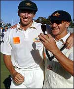 Glenn McGrath and Andy Bichel holds the replica Ashes