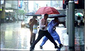 People run from rain storm in Sydney, AP