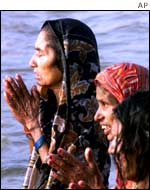 Women praying at the site of the Saraswati during Kumbh Mela