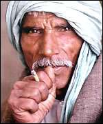 Man smoking a bidi