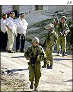 Israel settlers and soldiers in Hebron