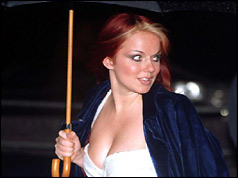 Geri Halliwell shelters from the rain - December 1997