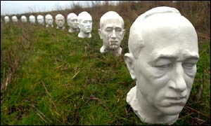 Busts of President Benes lined up along the border