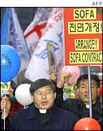 South Korean protesters march towards the US embassy in Seoul on Tuesday