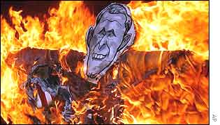 An effigy of US President George Bush is set fire by anti-US protesters in a rally in Seoul on Saturday