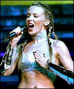 Kylie Minogue sings in concert