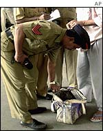 Indian police conduct a search at a Bombay railway station