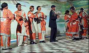 Papa Wendo with his dance group