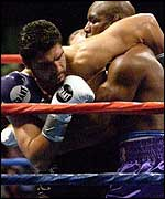 John Ruiz (left) grapples with Evander Holyfield