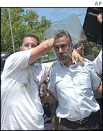 Police shield President Xanana Gusmao from rioters