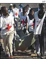 Rescue workers recover a body