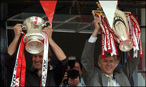 Tony Adams and Arsene Wenger celebrate the Double