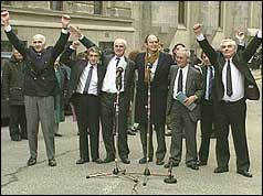 Birmingham Six group round microphone outside Old Bailey