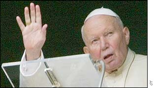 Pope John Paul II waves from window