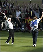 Paul McGinley celebrates as he sees his putt sink to win the Ryder Cup