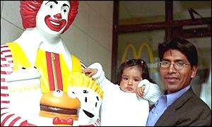Child and adult with Ronald McDonald statue