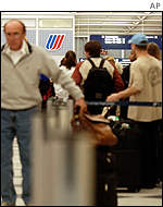 Passengers wait in line for a ticket agent at United's terminal in Chicago O'Hare International Airport.