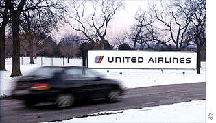 Cars enter UAL Corp headquarters in suburban Chicago on Thursday.