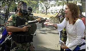 Protester remonstrates with soldier in Caracas on Tuesday