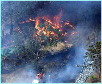 A house burns in Sydney in this shot taken from the air
