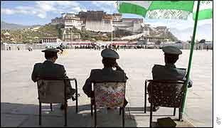 Chinese police look over the Potala Palace in Lhasa, Tibet