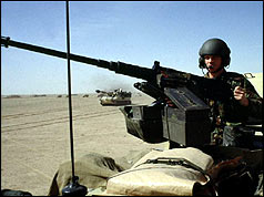 Soldier from British Tank Division patrols the desert north of Kuwait City