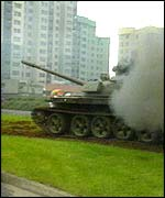 Yugoslav tank firing on apartment blocks