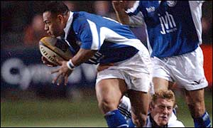 Bridgend's Aisea Havili beats Mike Tindall's tackle
