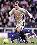 Portsmouth's Paul Merson runs with the ball